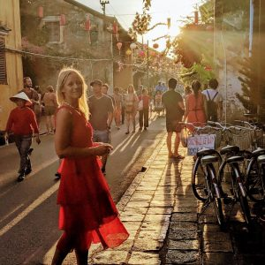 Anna walking down a street in Vietnam.