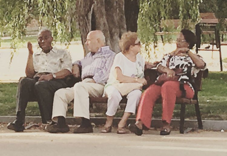 Grand Parents sitting at a park