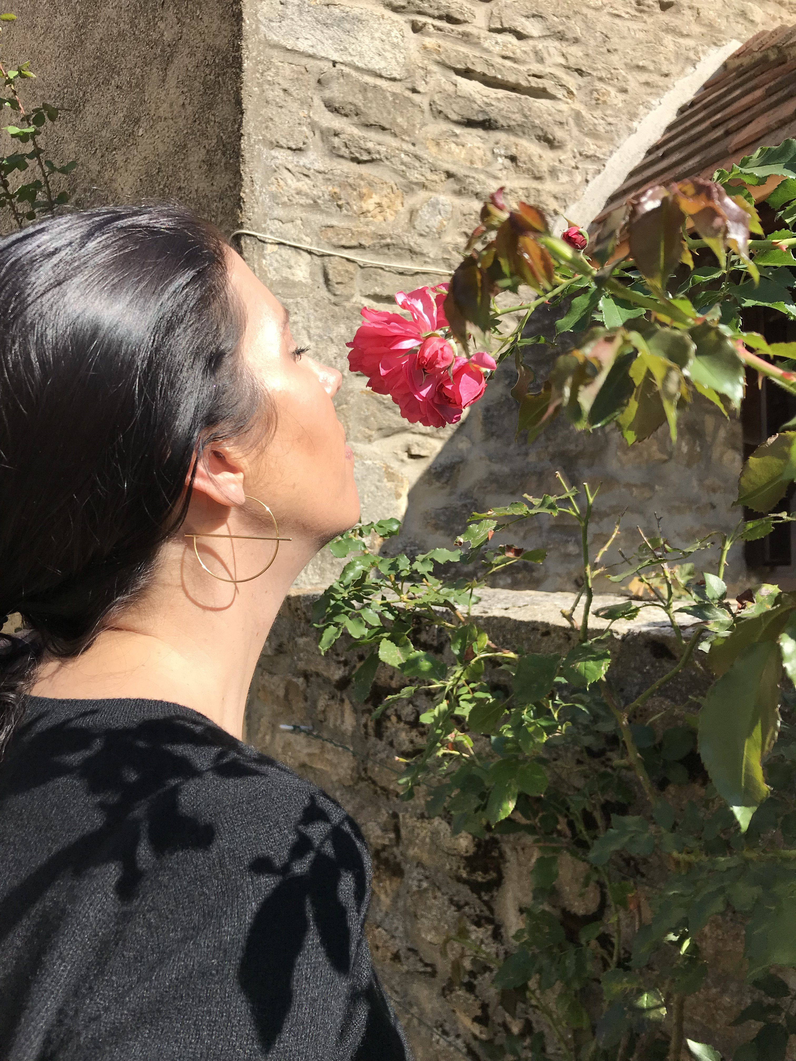 smelling rose in garden