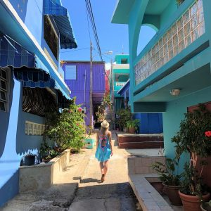 Anna walking down a brightly colored pedestrian street in Puerto Rico after her relocation