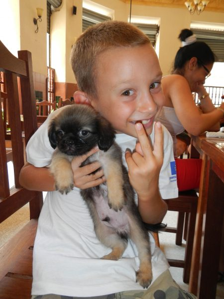A boy holding a puppy
