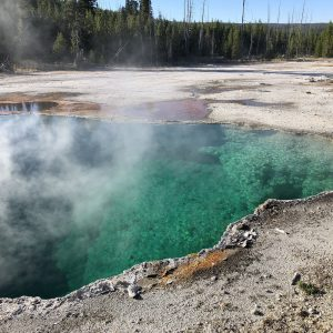 One of the steaming pools in Yellowstone National Park, USA.