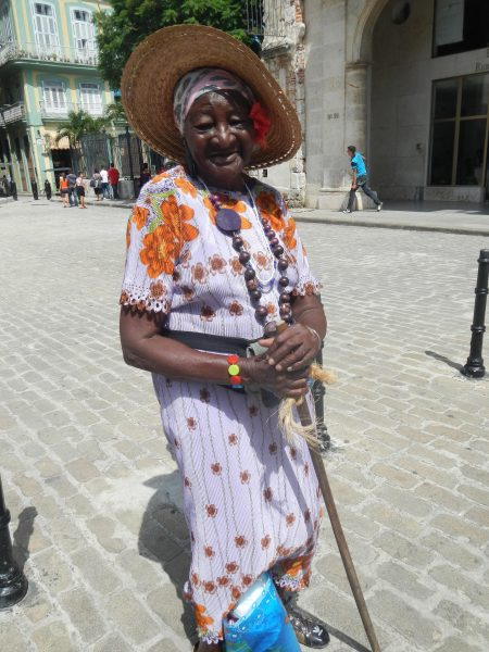 A woman holding a long cigar