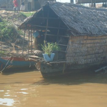 A photo of a compact houseboat in Kompong, Cambodia
