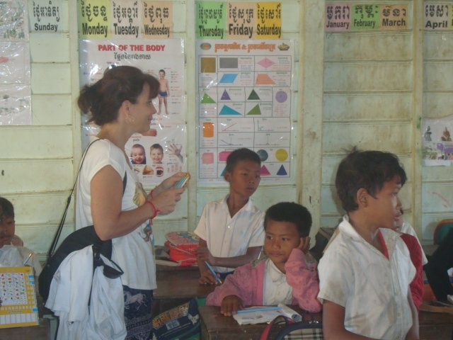 A photo of the tourist and Kompong Phluk, Cambodia children