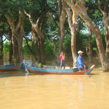 Two Kompong Phluk, Cambodia natives navigating the waterways