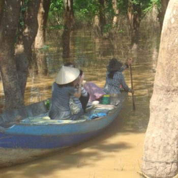 Two women navigating the waterways in the Flooded Forest