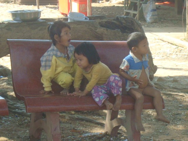 A photo of small kids playing on a bench in Kompong Phluk