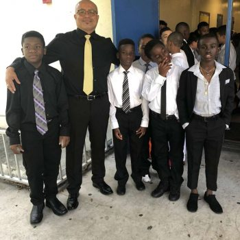 Jose posing with a group of students.