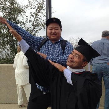 Jose dabbing with a student.