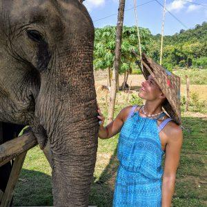 Anna petting an elephant in Laos.