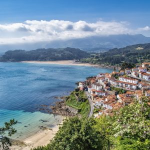 The beautiful coastal town of Asturias, where Marcos lived before becoming a hospitality professional