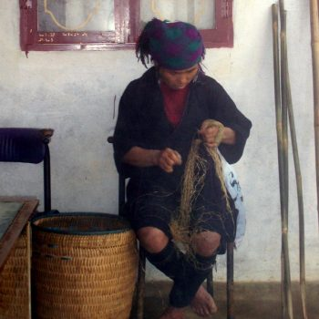 A woman weaving a basket, one of the many reasons to visit Sa Pa