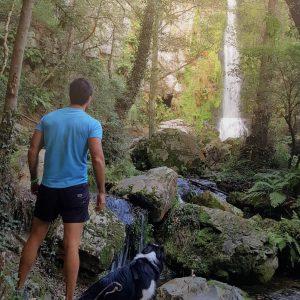 Marcos. hospitality professional, and his dog hiking at Cascadas de Oneta in Asturias.