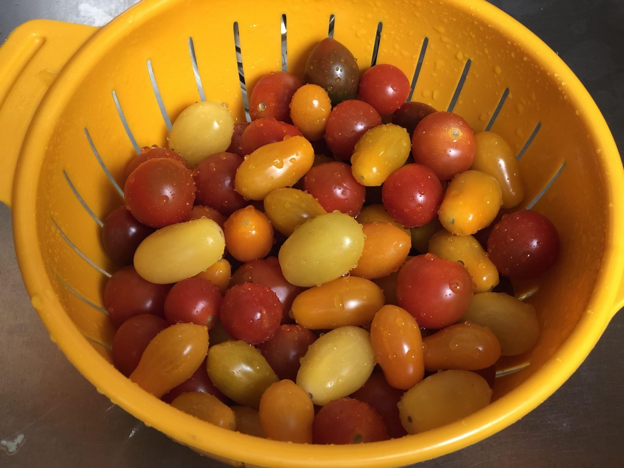 cherry tomatoes in a strainer