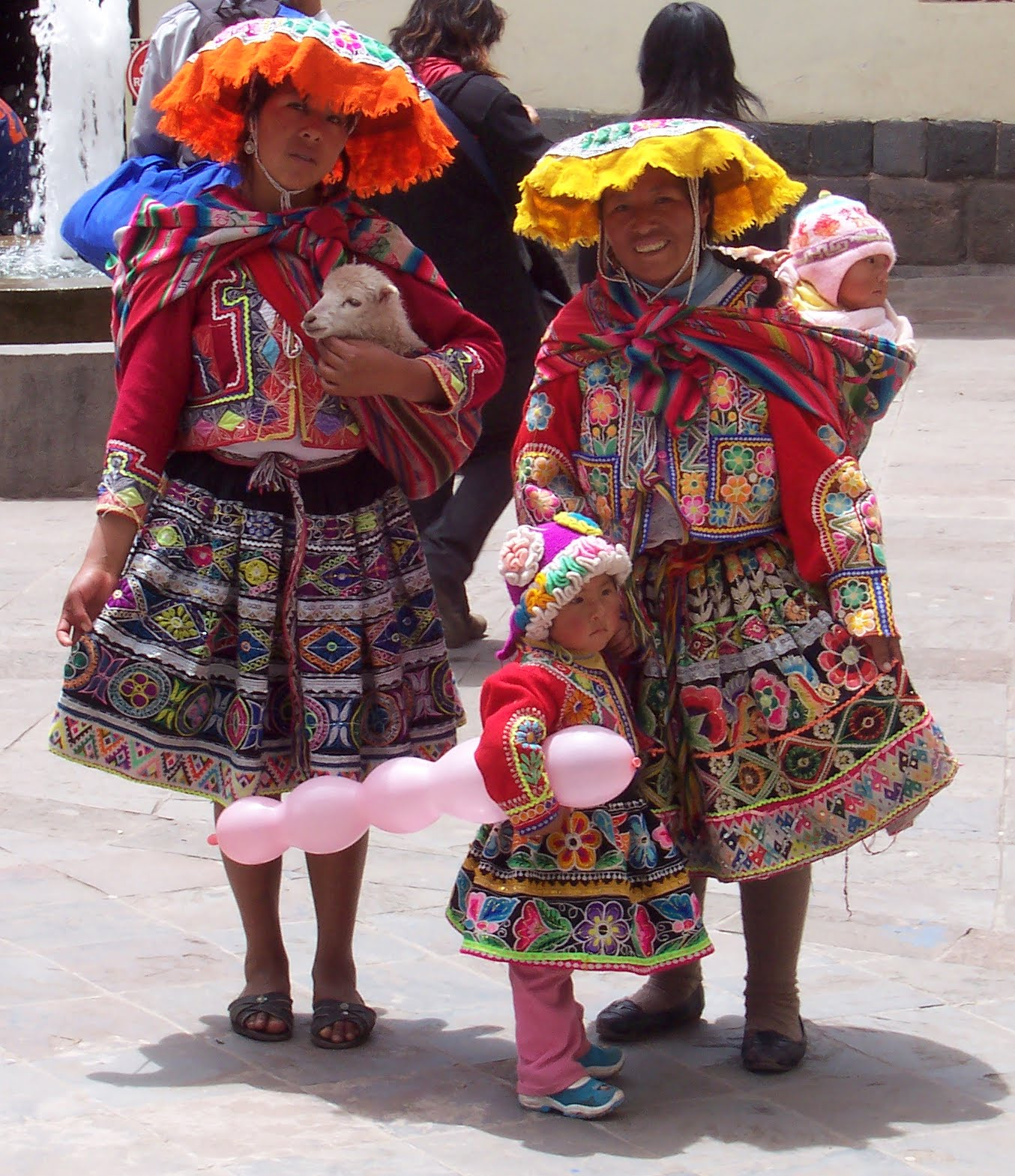 Women clad in traditional clothes on the street of Cusco, Peru.