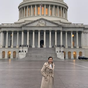 A photo of Leesa in front of the capitol building.