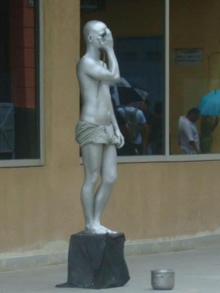 A photo of a human statue in Havana