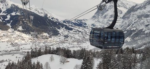 A gondola with a valley in the background, which Adam photographed while skiing in Switzerland.