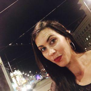 Leesa standing in front of a street in Europe.