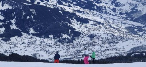 A family skiing in Switzerland at Grindelwald.