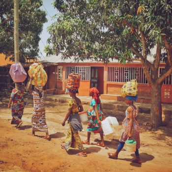 Women carrying baskets on their head in Guinea Bissau, West Africa