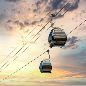 Cable cars against a sunset in Haifa.