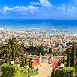 Jiye attends school in Israel in Haifa, near the Bahai Garden with the harbor in the back.