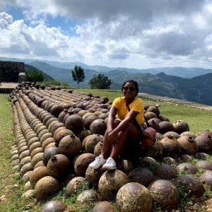 Paunise posing on a neat rock pile in Haiti
