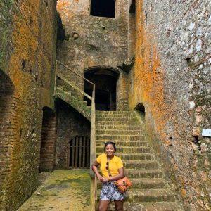 Paunise posing in a stairway in Haiti.