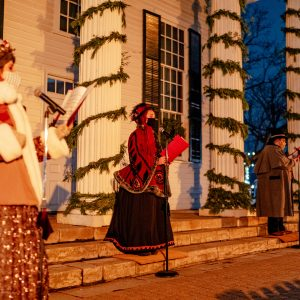 Photo by Nick Hagen. Holiday Nights Carolers sing at Townhall.