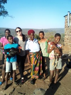 Rachel with her host family from her time with Peace Corps