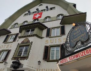 Looking up at Hotel Schweizerhof after skiing in Switzerland.