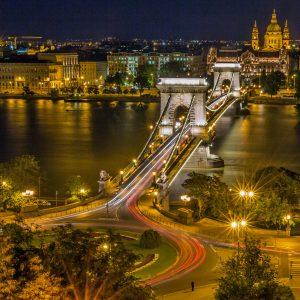 Night traffic across a bridge in Hungary.