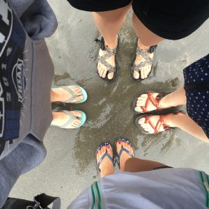 Cassidy and friends dipping their toes in the Mediterranean Sea