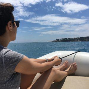 Dounia holding onto the skiff in the Mediterranean Sea