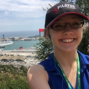 Cassidy in front of a seaside view in Barcelona