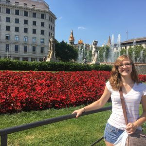 Cassidy in front of some roses at Retiro Park in Madrid during her Euro tour.