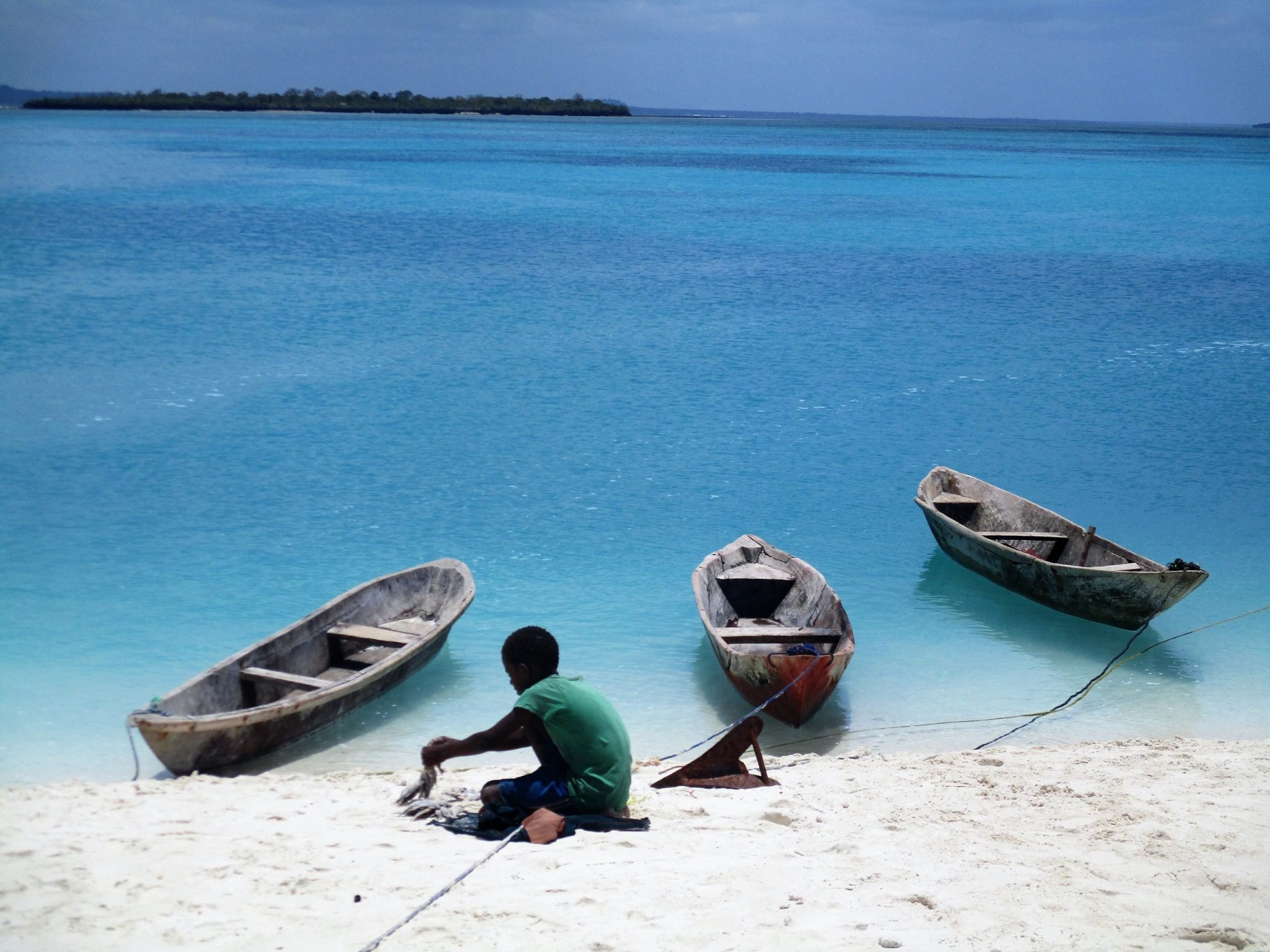 A photo of the beach with boats.