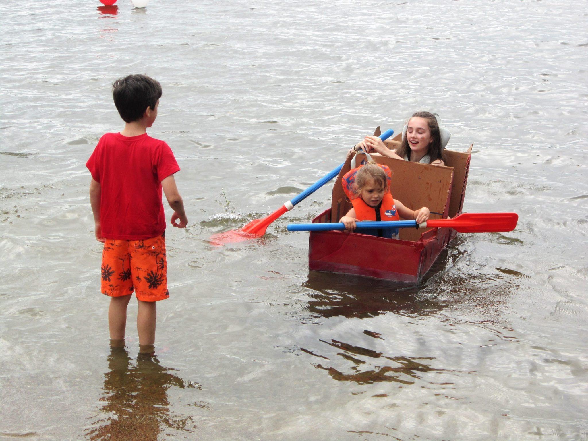 Tips for international travel: three children in a makeshift boat.