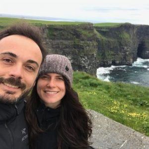 Sam and her husband in front of the Cliffs of Moher