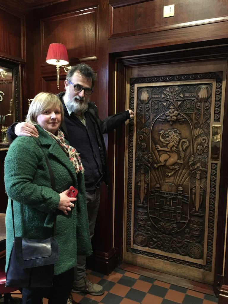 Jim Murty and his wife in front of a Ballymoney door in Northern Ireland