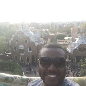 A selfie of Justin with European buildings in the background