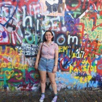 Kate Clark in front of Prague Lennon Wall