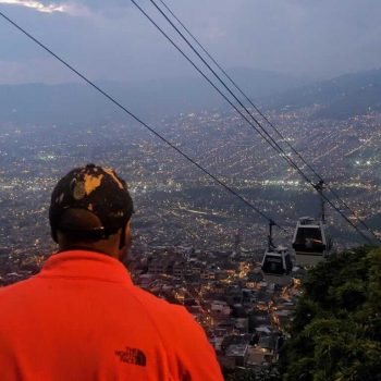 Lamon looking at a gondola from above the city.