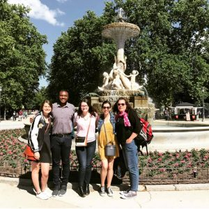 Leesa and close friends in front of a fountain in Madrid.