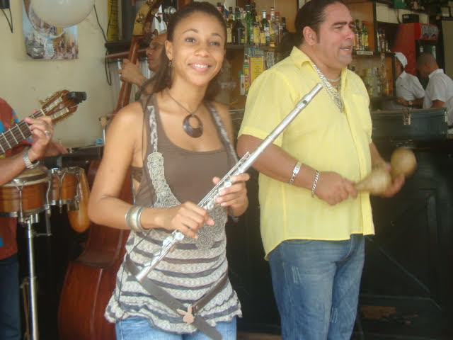 A photo of a girl holding a flute.