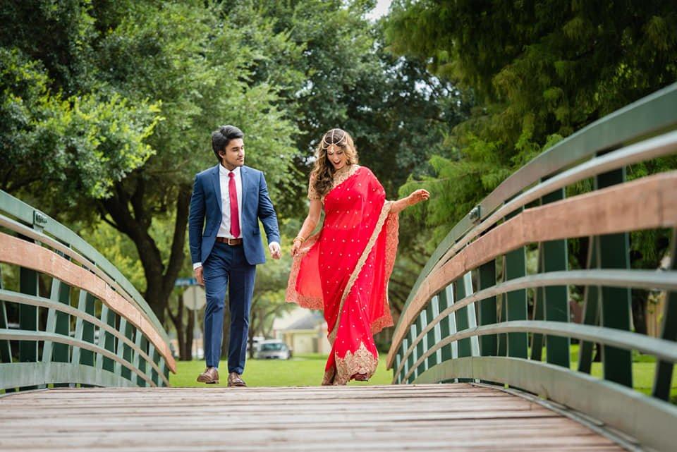Morgan walking across a bridge with her husband.