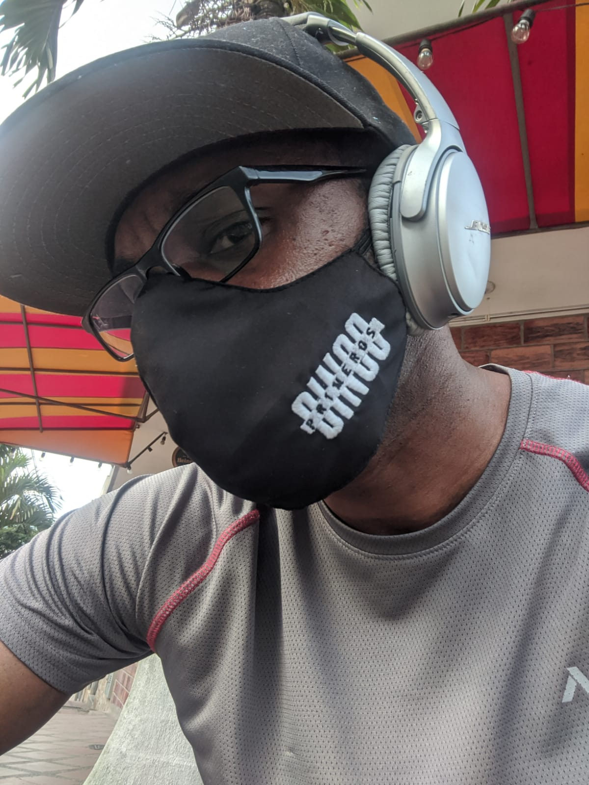 A picture of Lamon wearing a mask and large headphones in Medellin, Colombia
