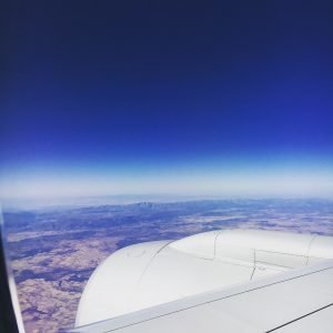 An airplane wing in the sky before arriving in Madrid.